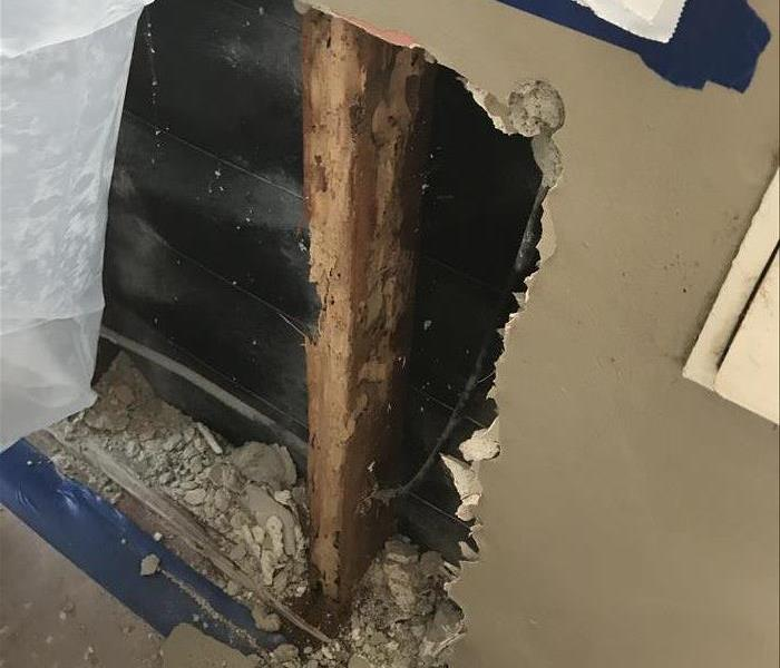 Fire damage being discovered past drywall