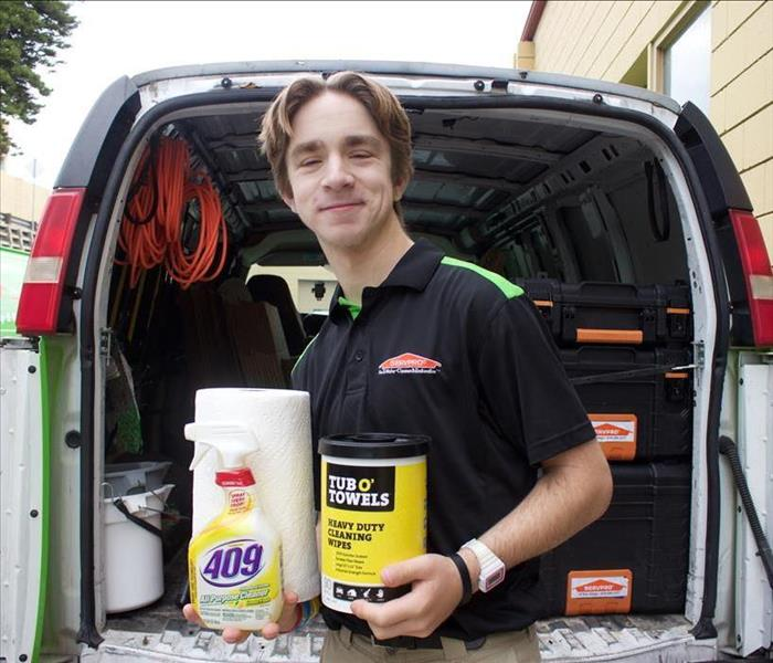 SERVPRO of San Diego East technician posing with cleaning supplies