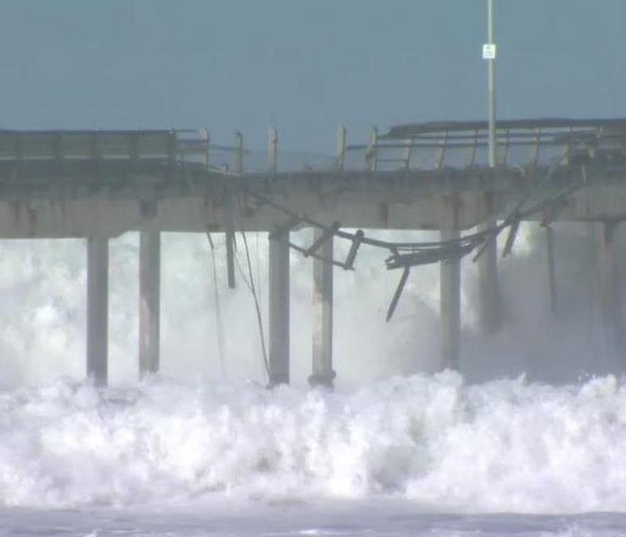 The Ocean Beach Pier being washed away